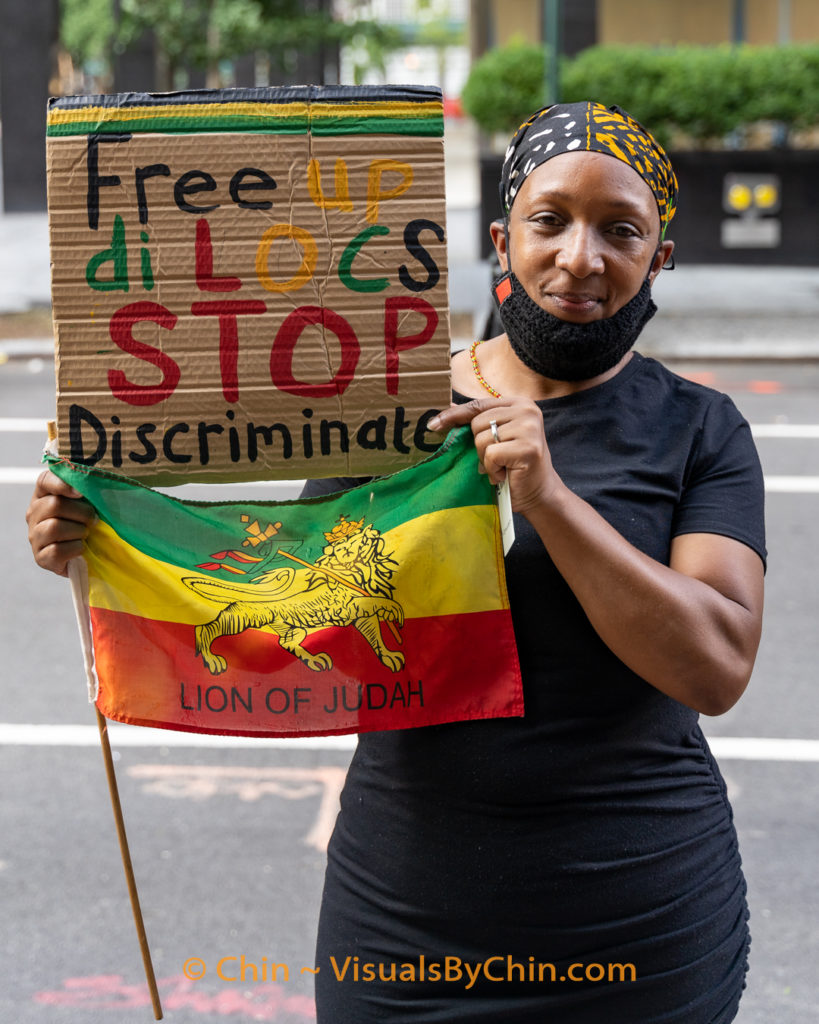Woman holding sign and flag