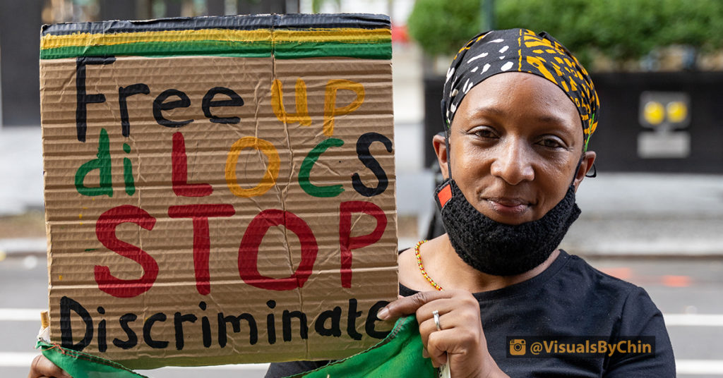 Black woman holding sign